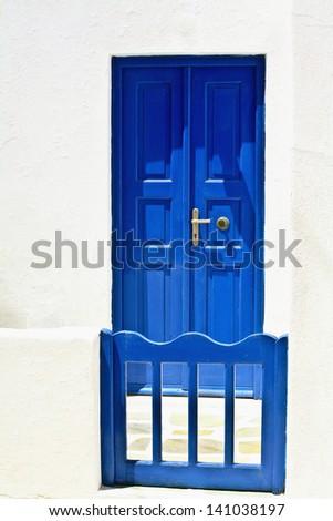 Blue Door and Gate in Mykonos Greece - stock photo