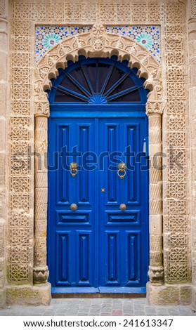 Blue door in old harbor in Essaouira city, Morocco - stock photo