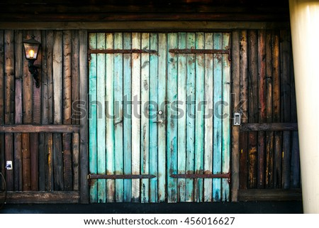 Blue door in the old wooden house - stock photo