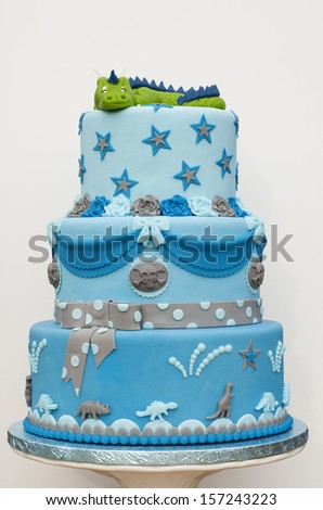 Blue dragon cake on a white background - stock photo