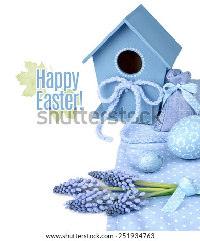 Blue Easter Border with grape hyacinth flowers, eggs and bird house isolated on white. - stock photo