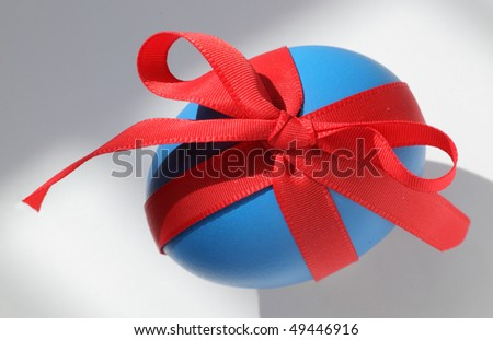 blue eastern egg with red ribbon - stock photo