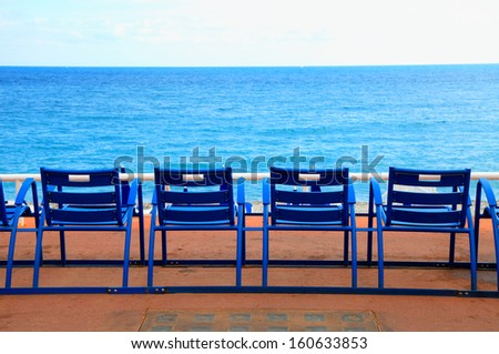 Blue empty chairs on Promenade des Anglais, Nice, France - stock photo