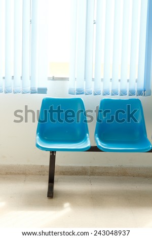 Blue empty chairs on waiting room. - stock photo