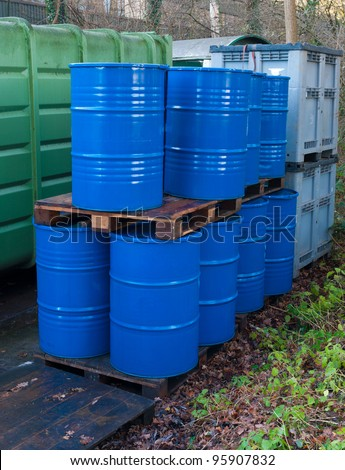 blue empty oil drums on an outside storage place - stock photo