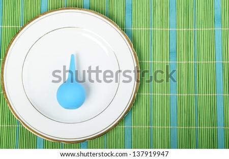 Blue enema on plate isolated on white background - stock photo