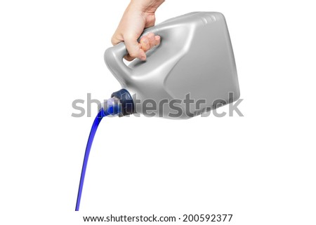 Blue engine oil pouring from a canister in hand isolated on white background - stock photo