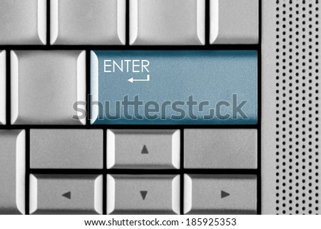 Blue Enter key on a computer keyboard with clipping path around the Enter key - stock photo