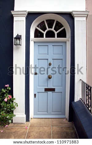 Blue entrance door in front of residential house - stock photo