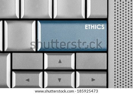 Blue Ethics key on a computer keyboard with clipping path around the Ethics key - stock photo