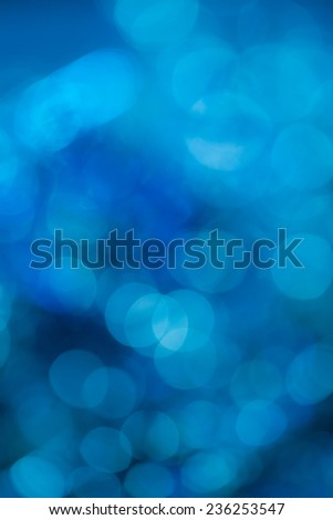 Blue extravagant background. Abstract with bright twinkles, sparkles, blurred, defocused light. - stock photo