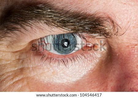 Blue Eye of mature man, close-up horizontal shot - stock photo