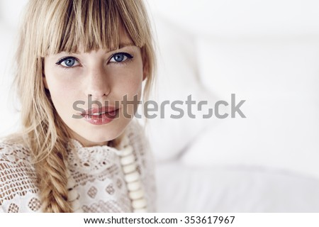 Blue eyed lady looking at camera - stock photo