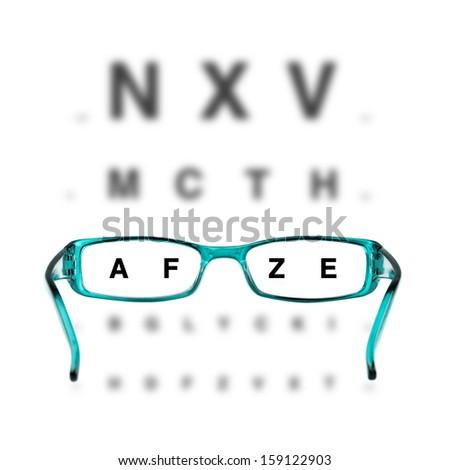 blue eyeglasses and eye-chart on white background - stock photo