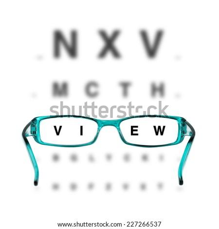 blue eyeglasses and eye chart on white background - stock photo