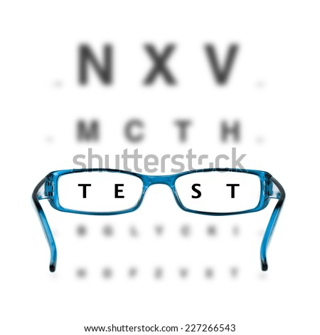 blue eyeglasses and eye chart on white background - stock photo