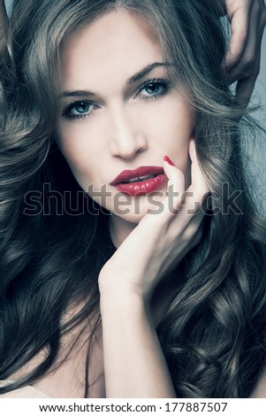 blue eyes  woman with long shiny hair  studio shot - stock photo