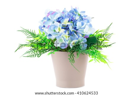 Blue fabric flowers in brown vase isolated on white background. - stock photo