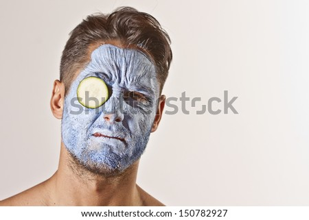 blue face-mask attractive man - stock photo