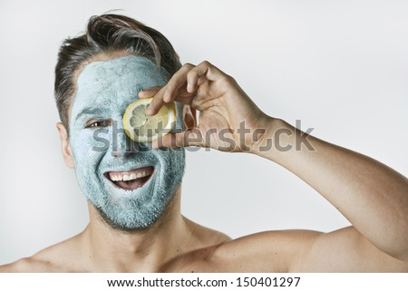 blue face mask smiling attractive man - stock photo