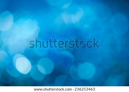 Blue festive New Year'?s background. Abstract with bright twinkles, sparkles, blurred, defocused light. - stock photo