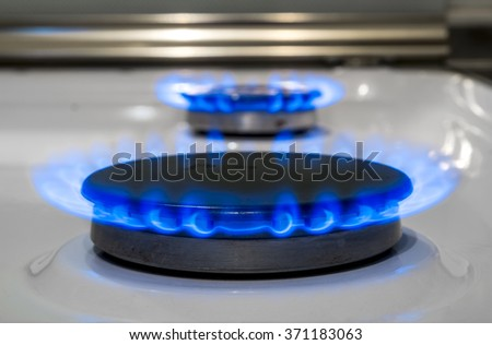 Blue fire burning gas burner household gas ovens - stock photo