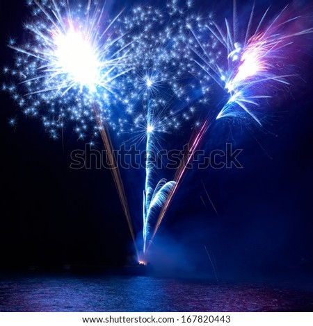Blue fireworks - stock photo