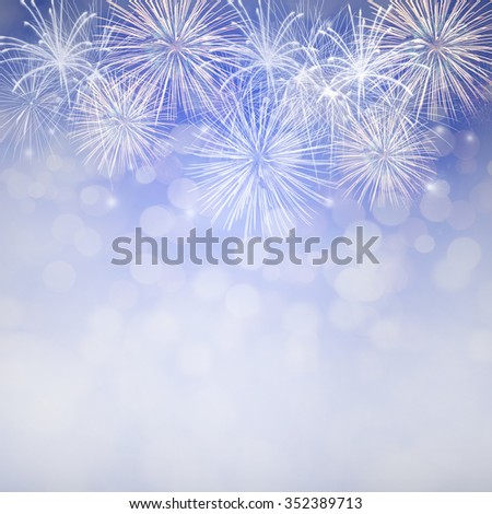 Blue fireworks at New Year and copy space, abstract background holiday - stock photo