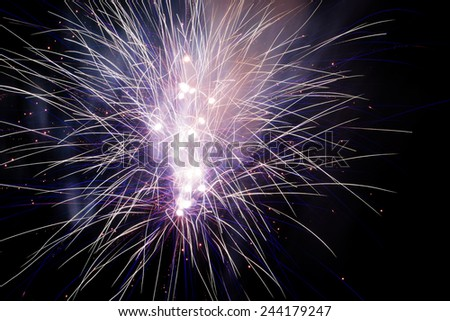 Blue fireworks explosions in the night sky - stock photo