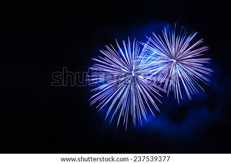 Blue fireworks with copy space on the left side - stock photo