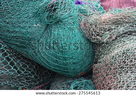 blue fishing net with knots - stock photo