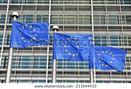Blue flags of European Union at European Commission building in Brussels - stock photo