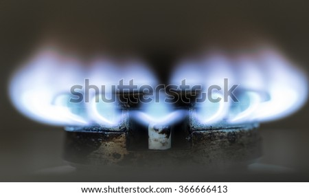 blue flame of natural gas fire as the background - stock photo