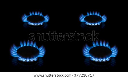 Blue flame of stove ring, burner. Crown of blue flame of kitchen stove. Isolated on black - stock photo
