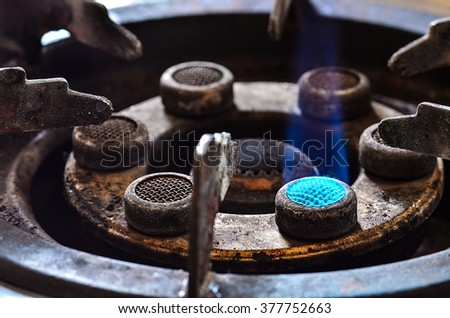 Blue flames of gas burning from a kitchen gas stove - stock photo