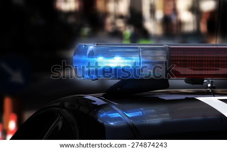 Blue flashing sirens of police car during the roadblock - stock photo