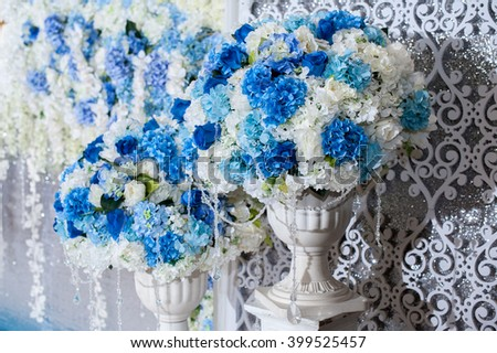 Blue flower on vases stand setting for Decorate with wedding backdrop for wedding party - stock photo