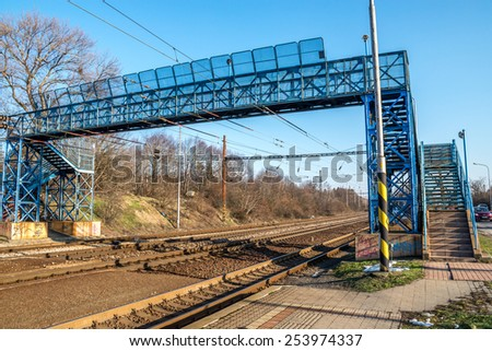 Blue footbridge over railroad, in Bratislava, Lamac, Slovakia - stock photo