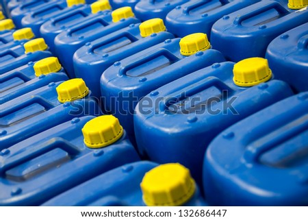 Blue Fuel Tanks With Yellow Caps - stock photo