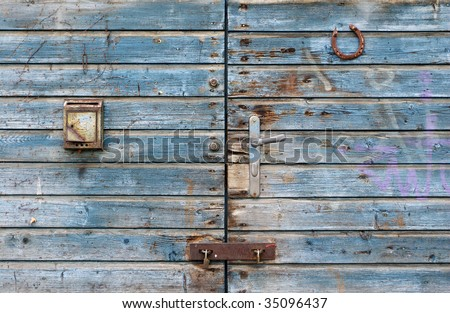 blue gate with a mailbox and horse shoe - stock photo