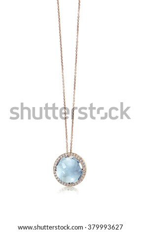 Blue Gemstone and Diamond Pendant Necklace isolated on a white background with a reflection - stock photo