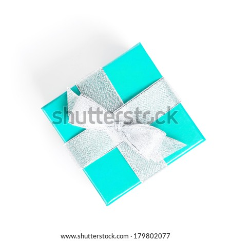 Blue gift box with silver ribbon. Isolated on white background. View from above - stock photo