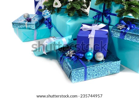 blue gift boxes under Christmas tree isolated on white - stock photo