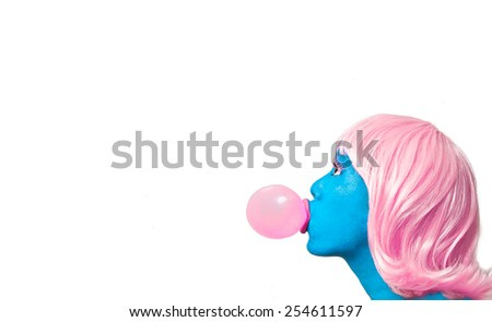 Blue GIrl with Pink Hair Blowing Bubble - stock photo