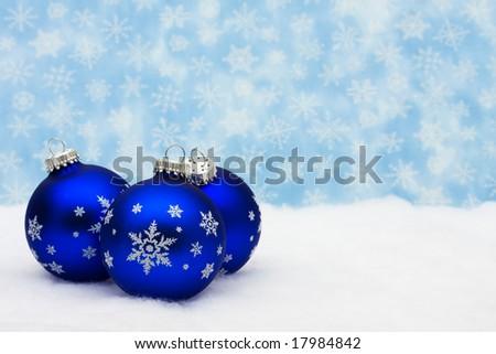 Blue glass Christmas balls on snowflake background, Christmas balls - stock photo