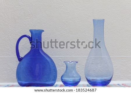 Blue Glass Jug and Vases   - stock photo