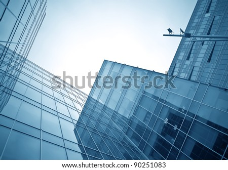 blue glass texture of transparent skyscrapers - stock photo