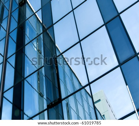 blue glass transparent wall of modern building house - stock photo