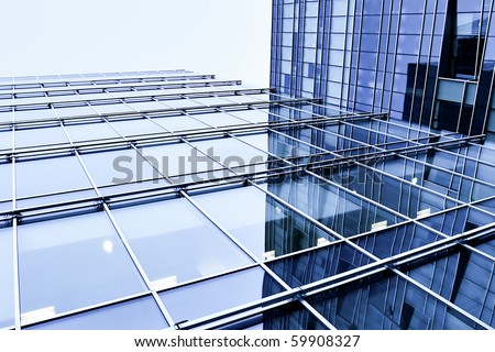 blue glass wall of modern commercial building - stock photo
