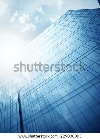 Blue glass wall of skyscraper - stock photo